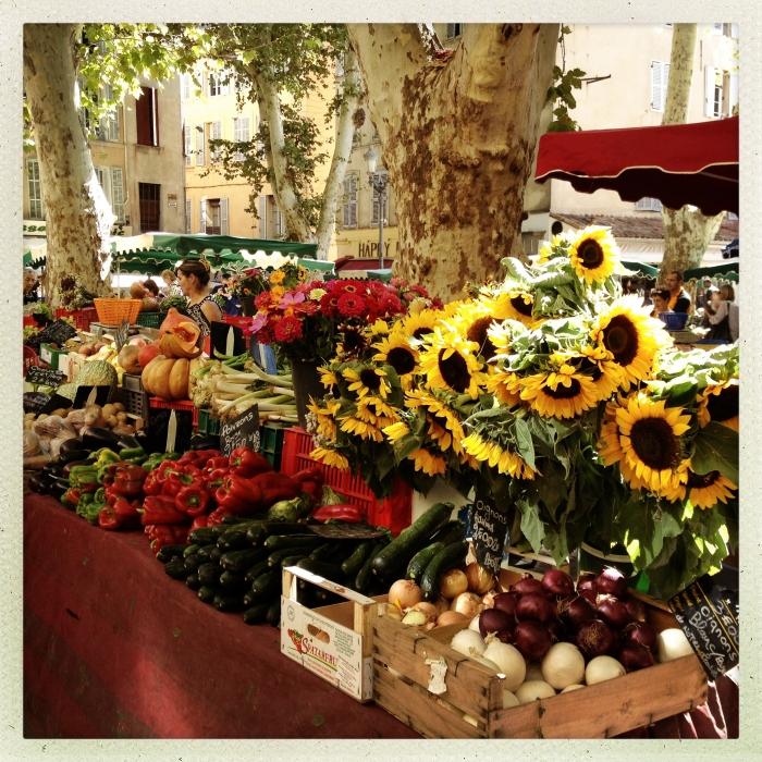 Gott in Frankreich: Sonnenblumen auf einem Markt