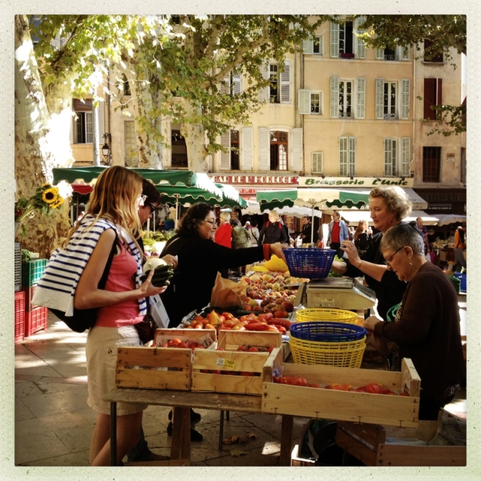 People selling vegetables on a market in Aix-en-Provence