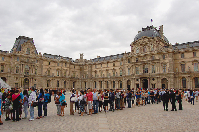 Loads of tourist queueing up in front of the Louvre museum in Paris