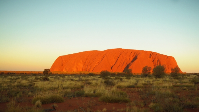 The Uluru glowing at sunset is one of the reasons to visit Australia