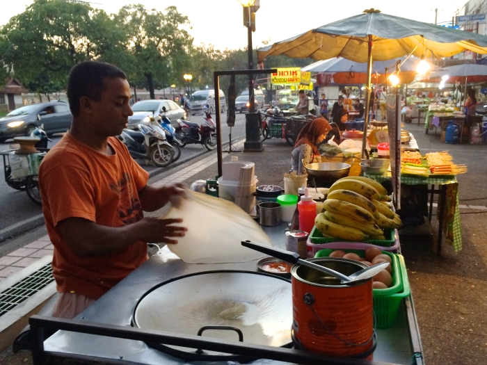A man making roti in a Chiang Mai Restaurant