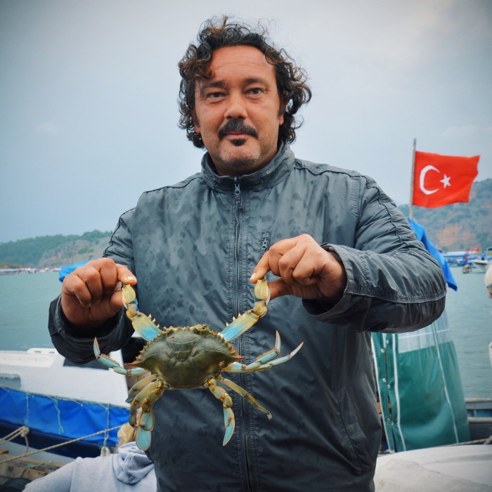 A local with crab at the Aegean