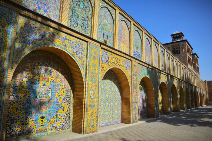 An long wall with colored tiles in the Golestan Palace in Tehran