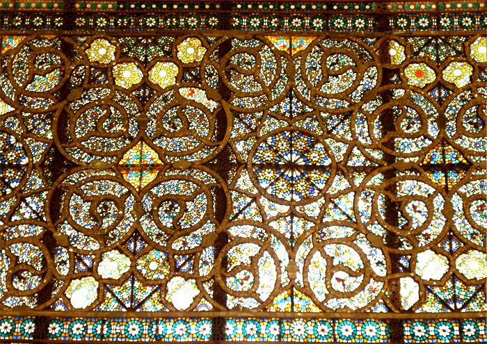 A detailed wall made of mirrors and mosaics in the Golestan Palace