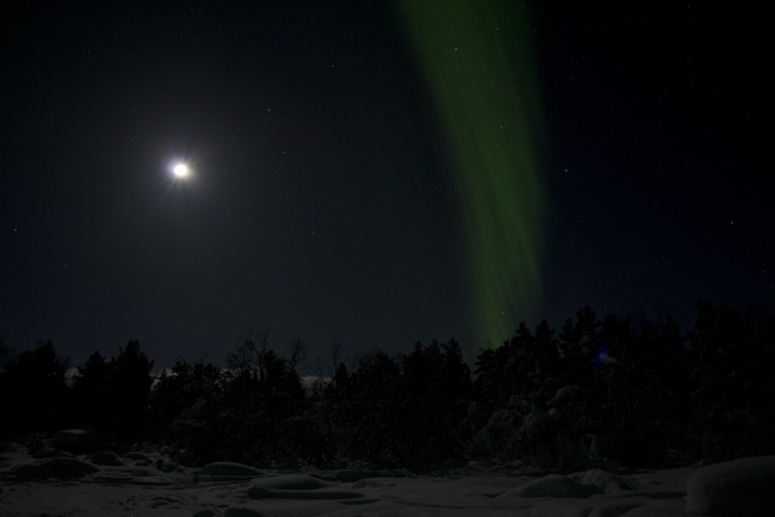 The moon and the Northern Lights at Kiruna in Sweden